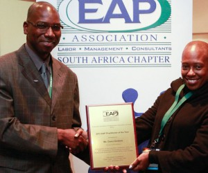 Mr. Tshifhiwa Mamaila (EAPA-SA President) left. Ms. Ouma Garekwe right - accepting Practioner of the Year(3).jpg