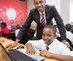Adapt IT CEO Sbu Shabalala and Zwakele Primary student.jpg